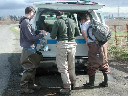 Contractors for the EPA's Supefund Technical Assessment and Response Team gathering sediment samples 3/4/09 at a wetland location near Vancouver Lake.